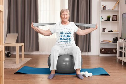 T-Shirt Mockup of an Elderly Woman Doing Pilates at Home 39604-r-el2