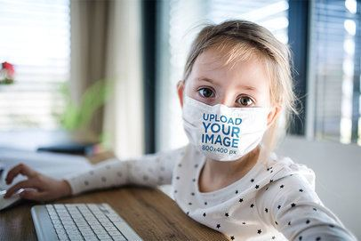 Face Mask Mockup of a Little Girl Using a Computer 39055-r-el2