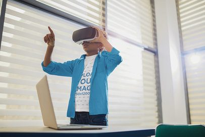 T-Shirt Mockup of a Young Boy Using a VR Headset in a Classroom 36402-r-el2