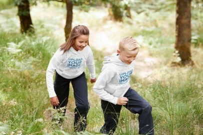 Hoodie Mockup Featuring a Boy and a Girl at the Mountains 39367-r-el2