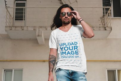 T-Shirt Mockup of a Long-Haired Man Wearing Sunglasses Outside of a Building 39361r-el2