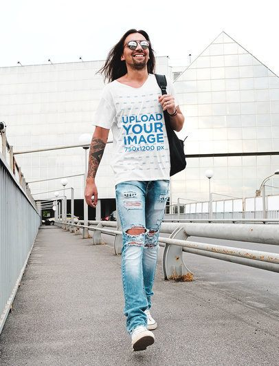 T-Shirt Mockup of a Tattooed Long-Haired Man with Ripped Jeans 38244r-el2