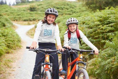 Hoodie Mockup of a Two Kids Biking in the Mountains 39382-r-el2