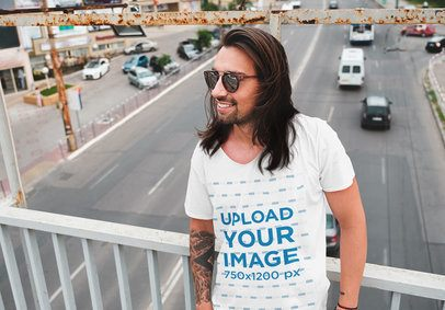 T-Shirt Mockup of a Carefree Tattooed Man Posing on an Urban Bridge 38263-r-el2