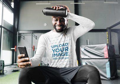 Long Sleeve Tee Mockup of a Man Checking His Phone at the Gym 39273-r-el2