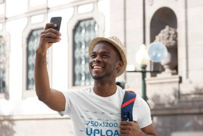 T-Shirt Mockup of a Man Taking a Selfie While Touring in the City 39040-r-el2