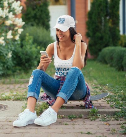 Dad Hat and Tank Top Mockup of a Woman Sitting on a Skateboard 34293-r-el2