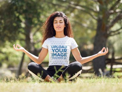 T-Shirt Mockup of a Young Woman with Curly Hair Meditating in the Park 35285-r-el2