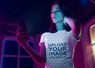 T-Shirt Mockup of a Woman Taking a Selfie with Cool Lighting 39102-r-el2