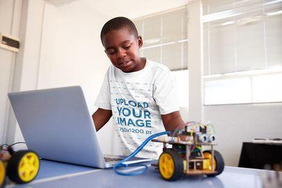 T-Shirt Mockup of a Kid Trying a Robotics Project at School 39098-r-el2