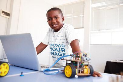 Tee Mockup of a Smiling Boy at a Robotics Classroom 39226-r-el2