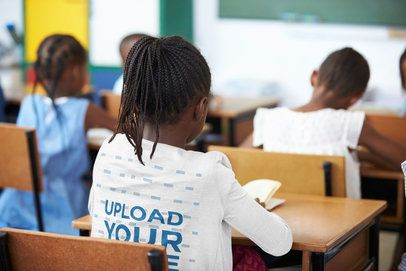 Back-View Mockup of a Girl with a Long Sleeve Tee at a Classroom 39223-r-el2