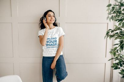 T-Shirt Mockup of a Woman with Headphones Leaning on a Wall 39256-r-el2