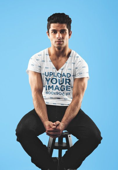 Mockup of a Muscular Man with a Heathered V-Neck T-Shirt at a Studio 35235-r-el2