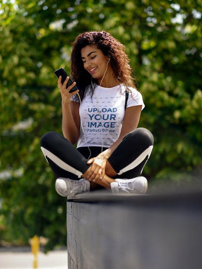 T-Shirt Mockup of a Young Woman Looking at Her Phone 38861-r-el2