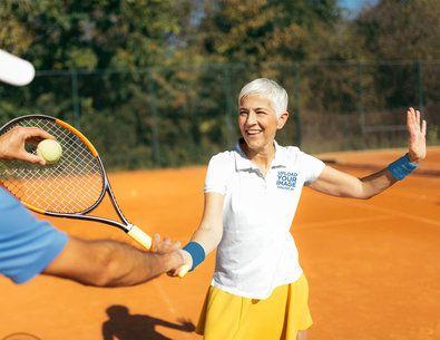 Polo Shirt Mockup of a Senior Woman Learning Tennis 39505-r-el2