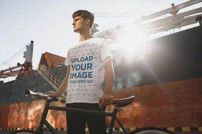T-Shirt Mockup of an Urban Cyclist Posing Under the Sun Light 37797-r-el2
