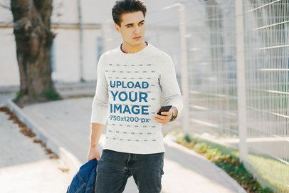Mockup of a Man with a Heather Long-Sleeve Tee Checking His Phone 37614-r-el2