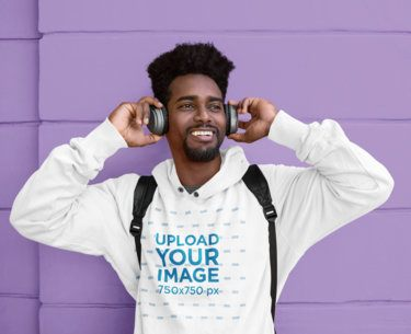 Hoodie Mockup of a Young Man Listening to Music 39194-r-el2