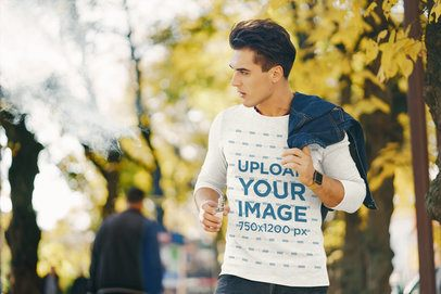 Mockup Featuring a Man with a Heather Long-Sleeve Tee Walking in the Park 37619-r-el2