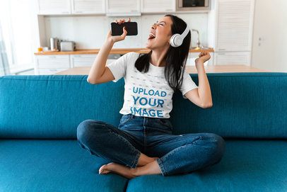 T-Shirt Mockup of a Young Woman Singing at Home 37822-r-el2