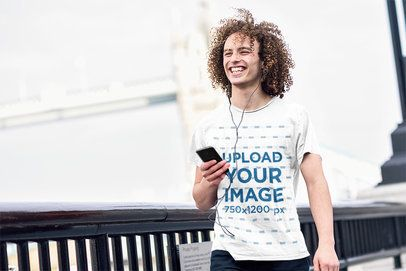 T-Shirt Mockup of a Man with Long Curly Hair Walking on the Street 38105-r-el2