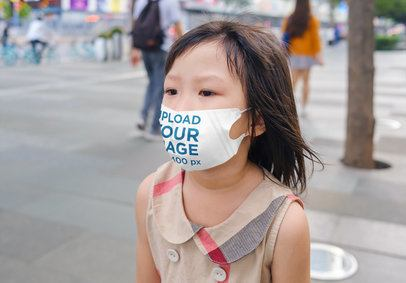 Face Mask Mockup Featuring a Little Girl Walking on the Street 39418-r-el2