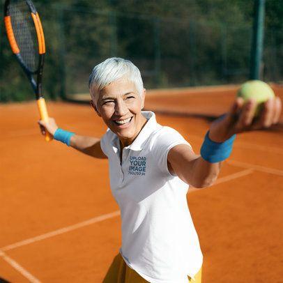 Polo Shirt Mockup Featuring a Senior Woman Playing Tennis 39507-r-el2