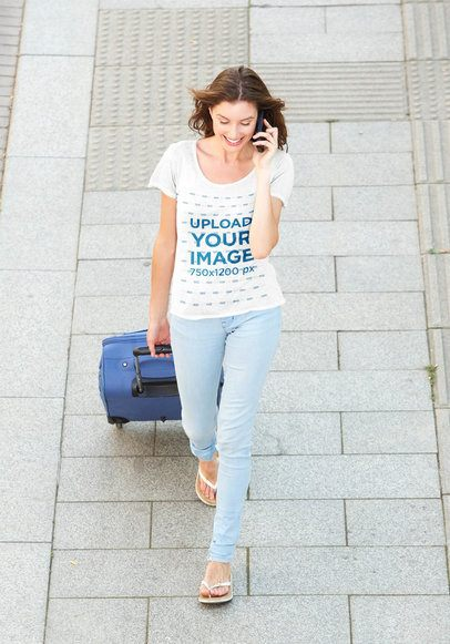T-Shirt Mockup of a Woman Walking on the Street with a Suitcase 38796-r-el2