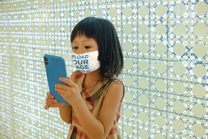 Face Mask Mockup of a Little Girl Staring at a Phone 39416-r-el2