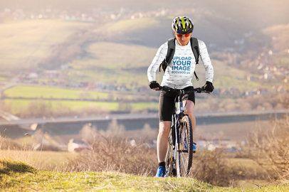 Long-Sleeve Tee Mockup of a Man Biking at the Mountains 38185-r-el2
