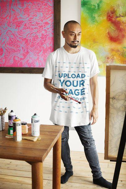 T-Shirt Mockup Featuring a Painter at His Studio 39449-r-el2