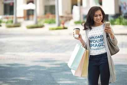 T-Shirt Mockup of a Woman Leaving the Mall 35805-r-el2