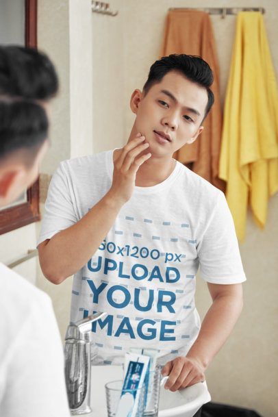 T-Shirt Mockup of a Young Man Checking His Beard on the Mirror 35806-r-el2