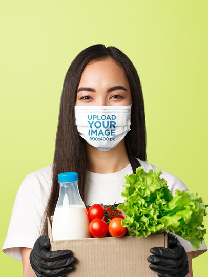 Face Mask Mockup of a Woman Holding a Box With Groceries 39940-r-el2