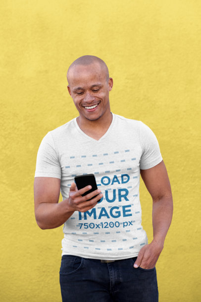 V-Neck Heather T-Shirt Mockup of a Man Looking at His Phone 37820-r-el2