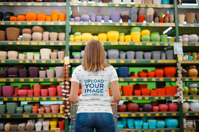 Back View Mockup of a Woman Wearing a Sublimated Tee at a Store 34893-r-el2