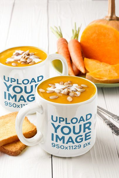 Mockup of Two Large Coffee Mugs Placed Next to Some Carrots 36059-r-el2