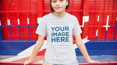 Mockup Video Of Trendy Young Girl Wearing A Tshirt Sitting Outside British Place a13008