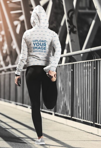 Back View Mockup of a Woman with a Sublimated Hoodie Stretching on the Street 34432-r-el2