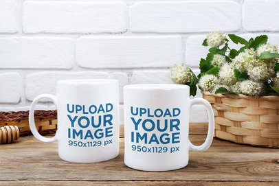 Mockup of Two Customizable 11 oz Mugs Placed Next to a Flower Basket 37130-r-el2