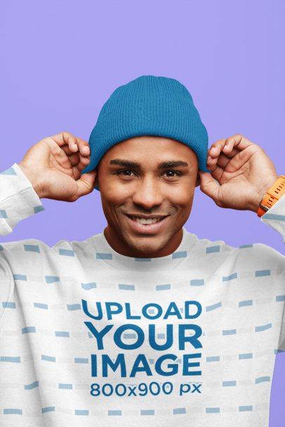 Mockup of a Happy Man Wearing a Sublimated Crewneck Sweatshirt at a Studio 37704-r-el2