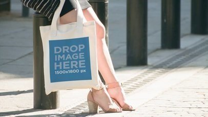 White Pretty Girl Carrying A Tote Bag While At Downtown Mockup Video a13914