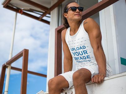 Mockup of a Lifeguard Wearing a Tank Top with Sunglasses at the Beach 12731
