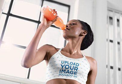Sports Bra Mockup Featuring a Woman Rehydrating Herself 35603-r-el2
