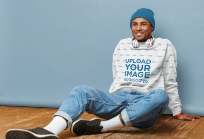 Sublimated Sweatshirt Mockup of a Happy Man Sitting in Front of a Customizable Background 38254-r-el2