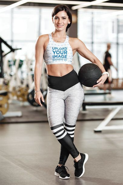 Sublimated Sports Bra Mockup Featuring a Happy Woman Holding a Ball 35283-r-el2