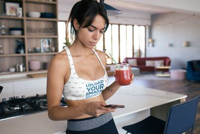 Sports Bra Mockup of a Woman Drinking Juice at Home 34853-r-el2
