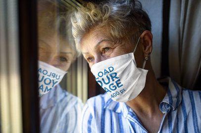 Face Mask Mockup of a Senior Woman Looking Through a Window 40552-r-el2