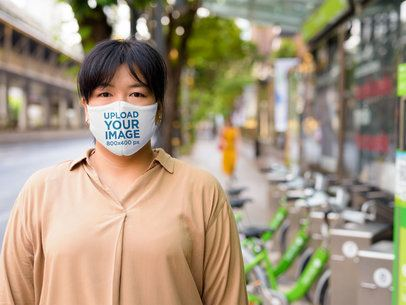 Mockup of a Serious Woman Wearing a Reusable Face Mask 40284-r-el2